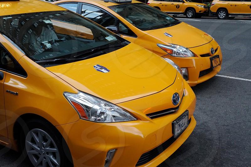 yellow toyota vios sedan cab photo
