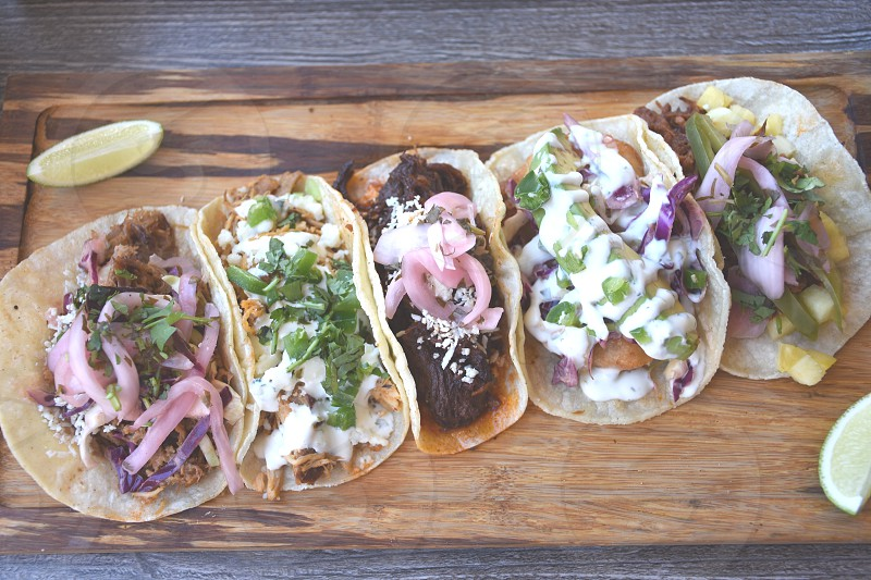 tacos on brown plate photo