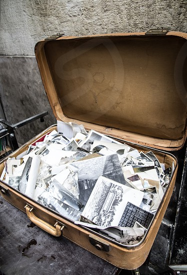Old suitcase full of b&w photos photo