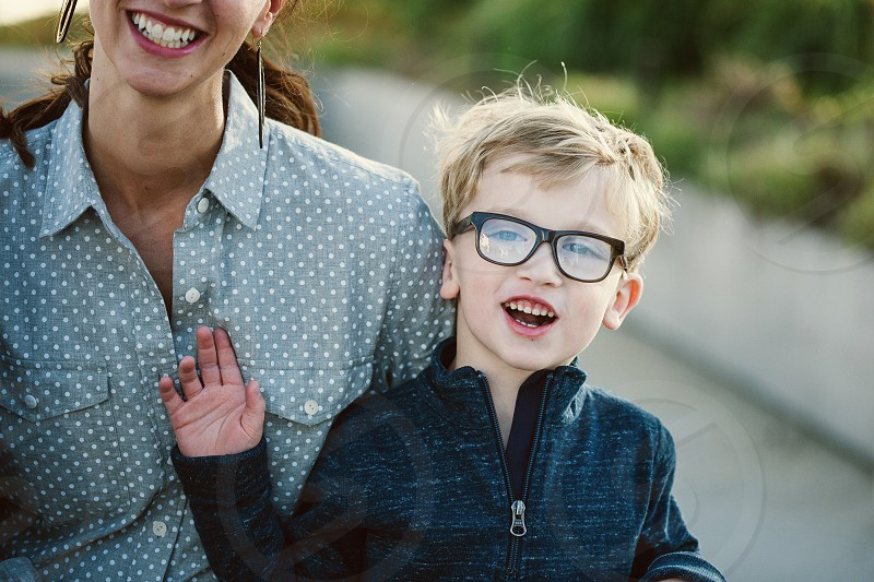 mother and son little boy smiling little boy with glasses happy family child kid lifestyle candid laugh photo