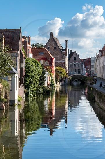 Buildings alongside a canal in Bruges West Flanders in Belgium photo