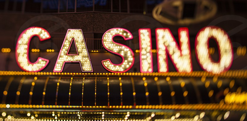Las Vegas casino neon lights tilt shift lens flashing signage typography font red yellow Sin City  photo
