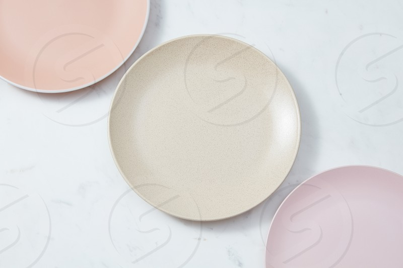 Top view of porcelain dishes handmade. Ceramic glazed plates are empty on a gray background with copy space. Flat lay photo