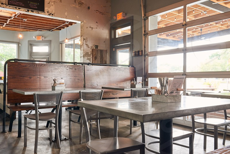 gray wooden dining chair in front of white wooden table photo