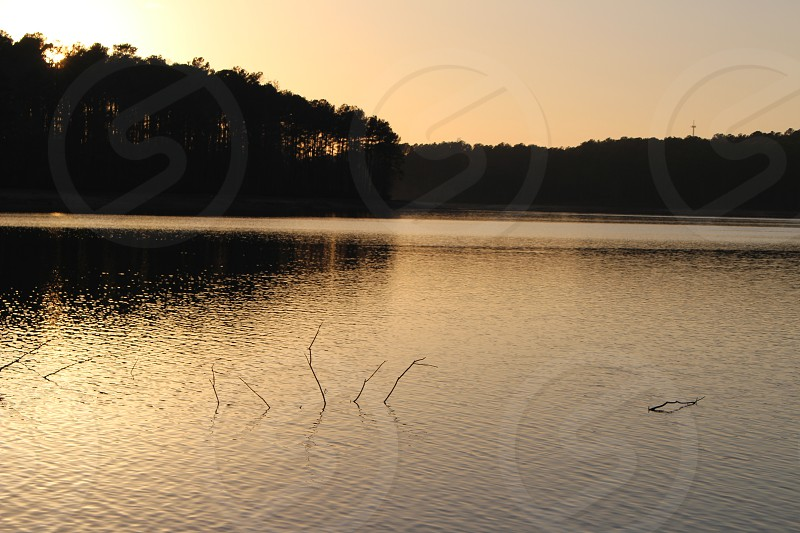 sunset over lake in winder georgia photo