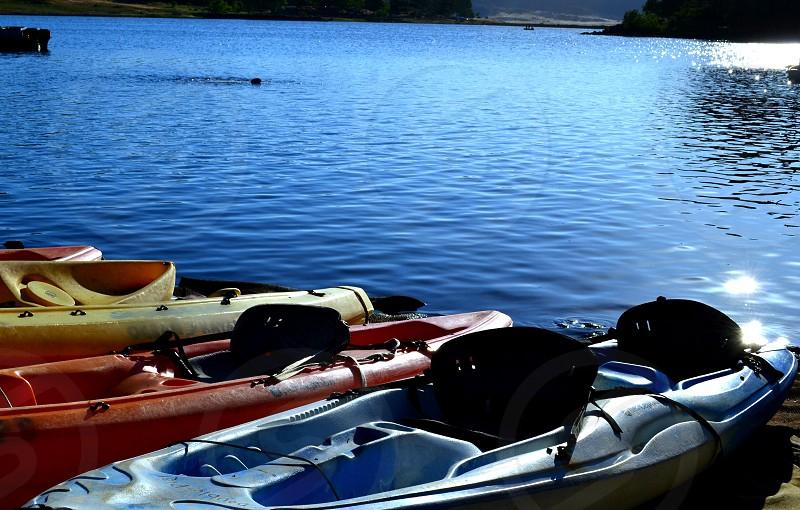 Kayaks on the lake-mountain lake water scene photo
