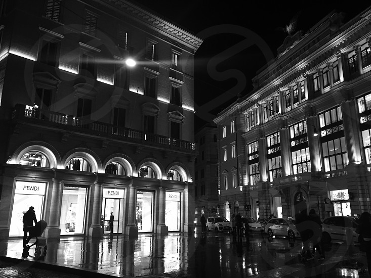 #corner #street #shops #fendi #hm #lights #rain #sidewalk #square #blackwhite  photo