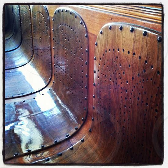 wooden seat on public transportation  photo