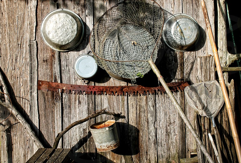 Fishing nets and camp cooking tins photo