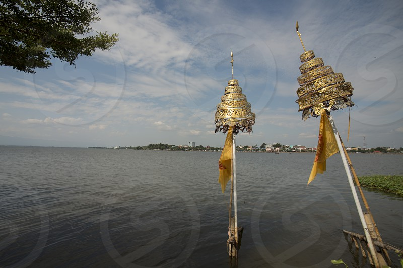 The Temple Island or wat Tiloke Aram Island at the lake of Kwan Phayao in the city of Phayao in North Thailand. photo