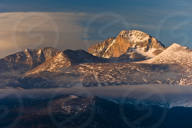 Long's Peak sunrise Rocky Mountain National Park near Estes Park Colorado with fog in foreground photo