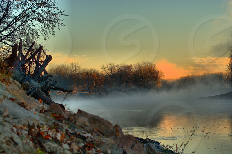 Foggy river at sunrise. photo