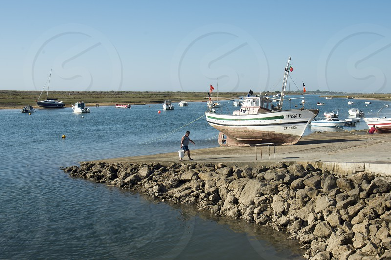 the landscape at the Armacao da Abobora Laguna and Coast at the Town of Cabanas near Tavira at the east Algarve in the south of Portugal in Europe. photo