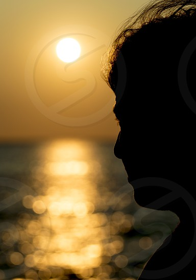 harmony calm peaceful thinking thoughtful woman girl sea sunshine photo