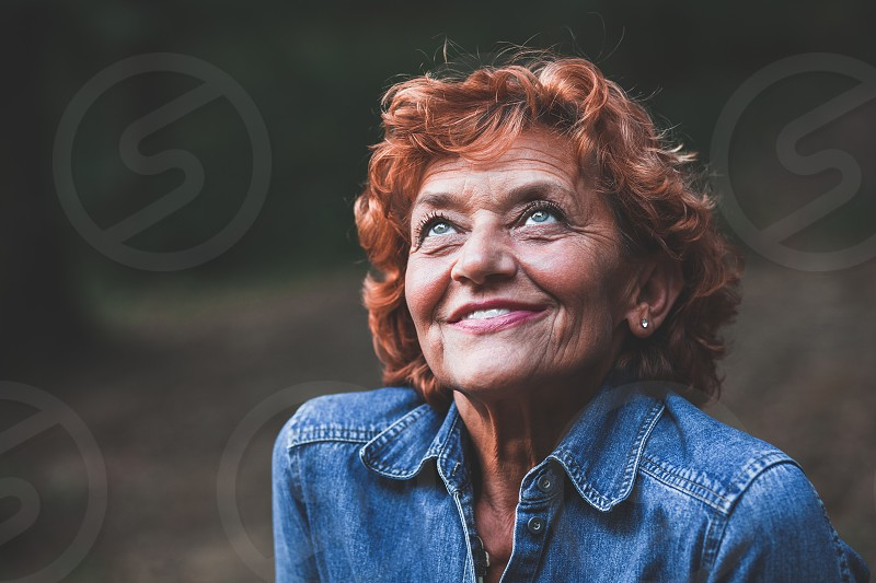 Portrait of a happy fifty year old woman outdoors photo
