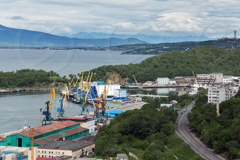 PETROPAVLOVSK-KAMCHATSKY KAMCHATKA RUSSIA - JULY 08 2013: View on commercial seaport Petropavlovsk-Kamchatsky city. Russia Far East Kamchatka Peninsula Avachinskaya Bay. photo