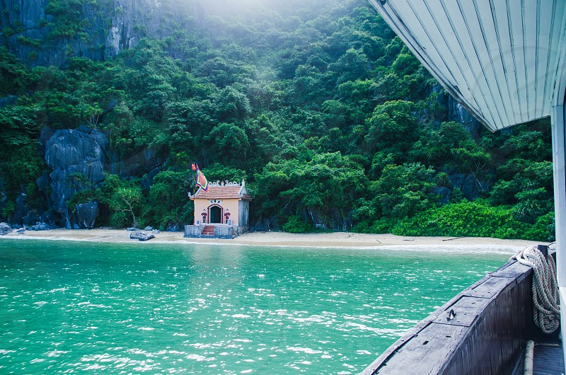 tropical hut in vietnam as seen by boat photo