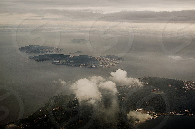 aerial islands water sea marmara bosphorus istanbul hazy grey gloomy clouds photo