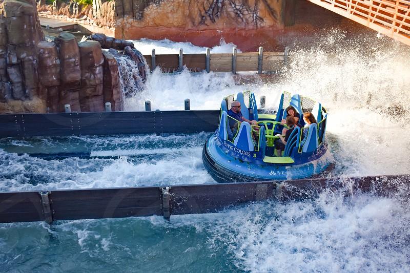 Orlando Florida. March 09 2019 People having fun Kraken rollercoaster at Seaworld Marine Theme Park (2) photo