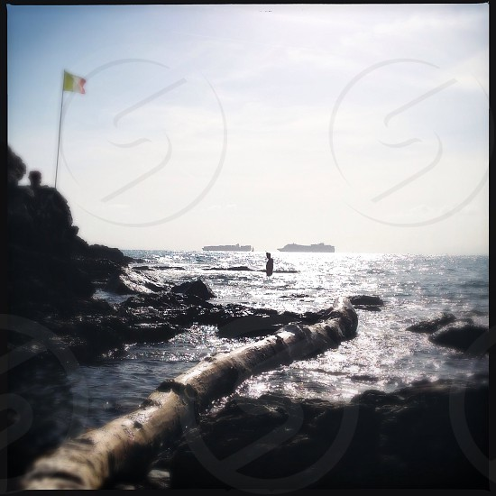 Sea ships flags silence blue sky rocks beach photo