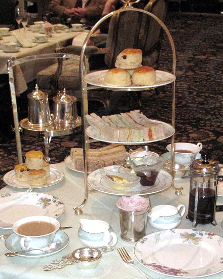 Savoy high tea sandwiches cakes scones silver coffee cream jam china  photo