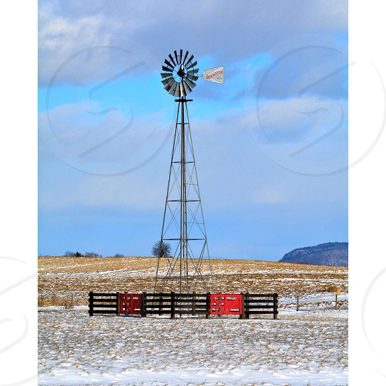 Rural shot with a windmill and renewable energy photo