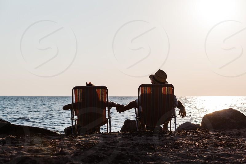 Couple enjoying sunset at a beach photo