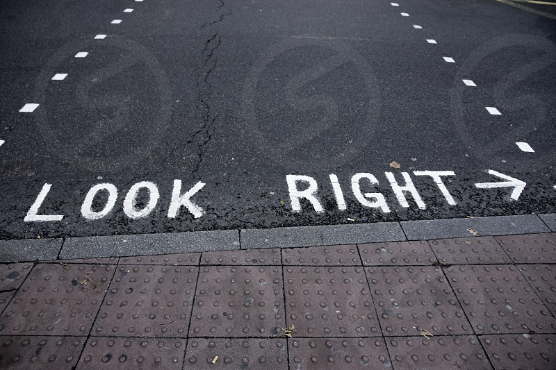 Advice for people crossing the streets in London. photo