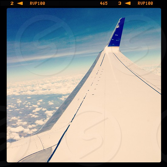 airplane wing in sky photo