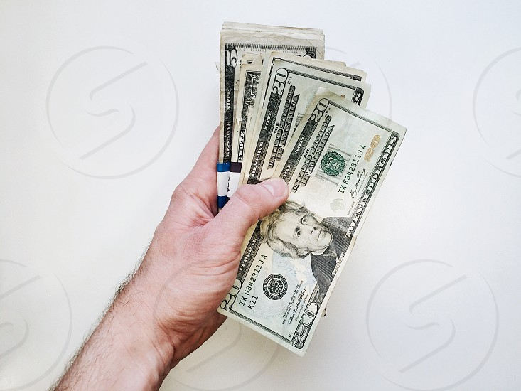 person holding four 20 u.s. dollar bill photo