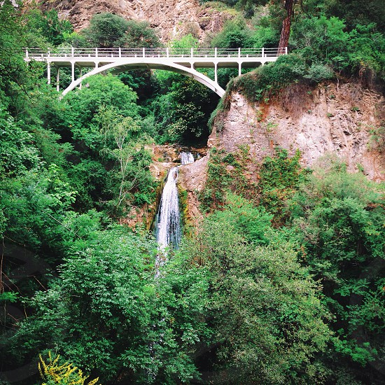 Waterfall and footbridge photo