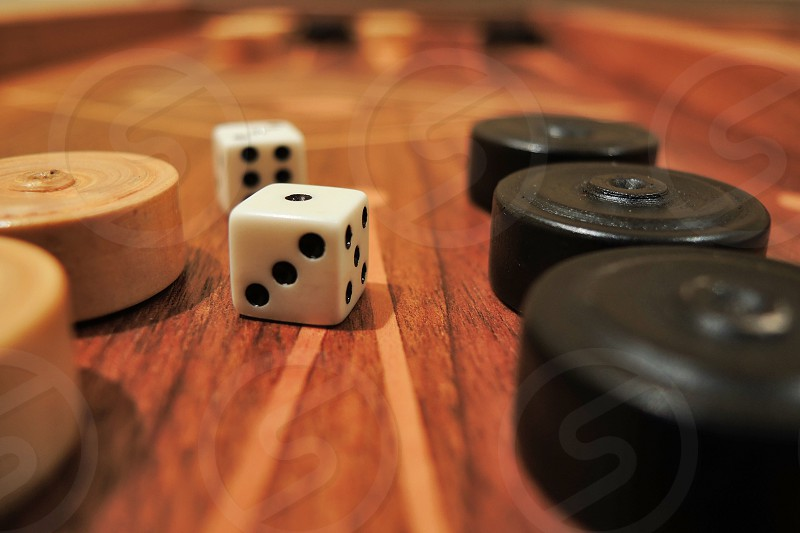 dice on board game beside board game piece photo