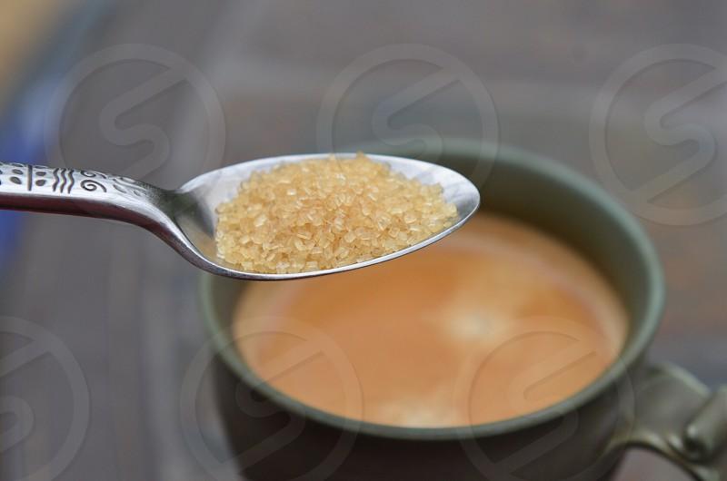 Teaspoon raw sugar cup coffee beverage sweetener  photo