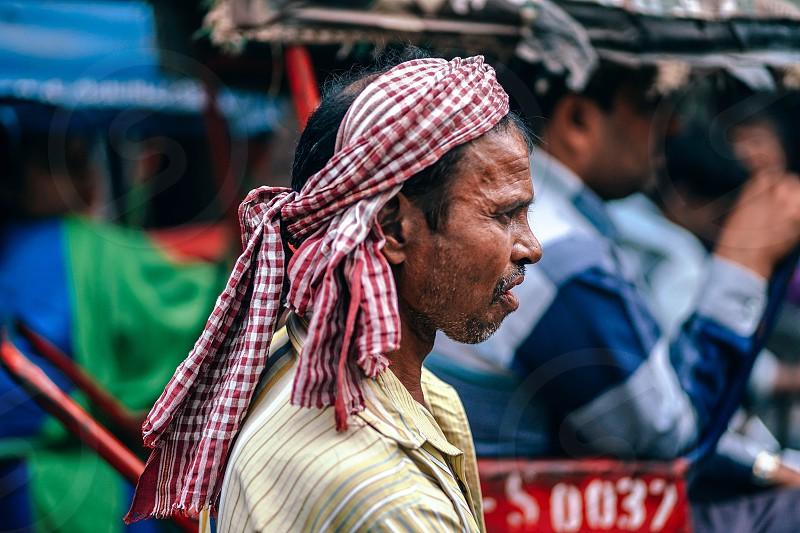 Indian auto rickshaw driver stuck in trafifc in New Delhi India. photo