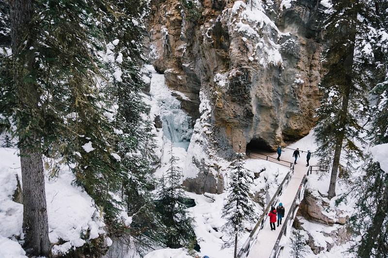 Alberta winter landscape Johnston Canyon snow evergreens national park cave falls bridge cliff  photo