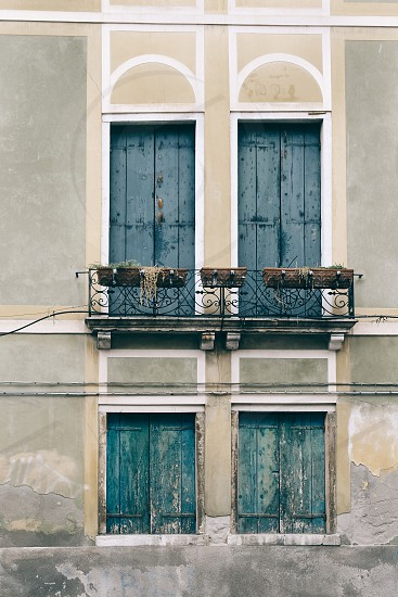 venice italy building facade doors windows shutters green photo