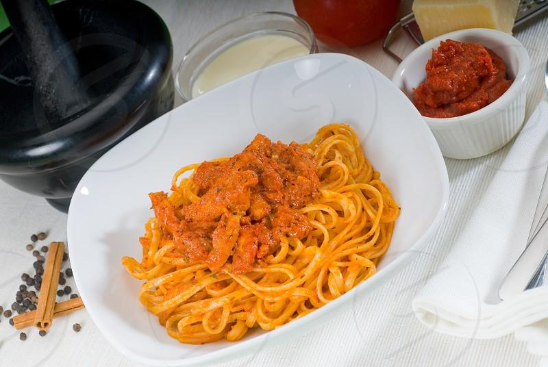 italian spaghetti pasta with fresh homemade tomato and chicken sauce photo