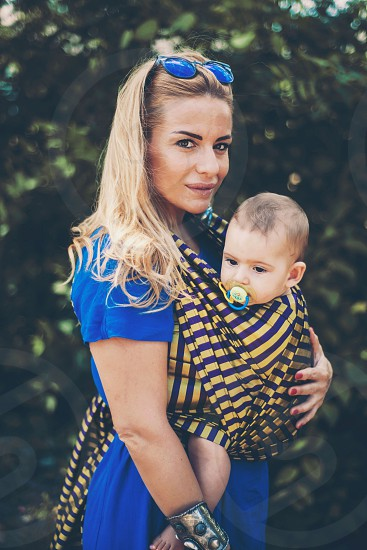 baby mom mother child kid woven wrap stripes summer day sunglasses blue dress photo