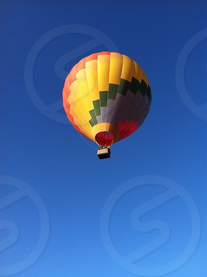 Hot air balloon in flight with no clouds. photo