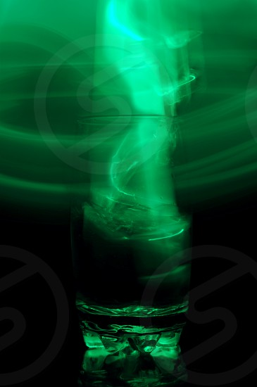 Swirling light out of a glass. photo