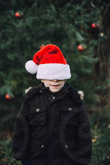 Child boy Christmas winter warm cozy Santa hat photo