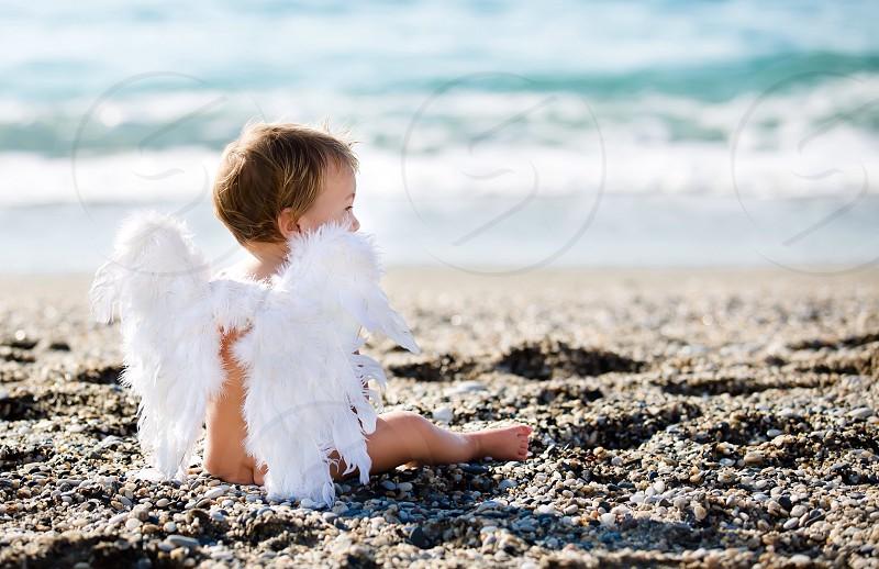 Little cute angel near the sea beach baby kid love angel wings sky water happy amazing photo memory feelings mom dad family #god #angel #sweet  photo