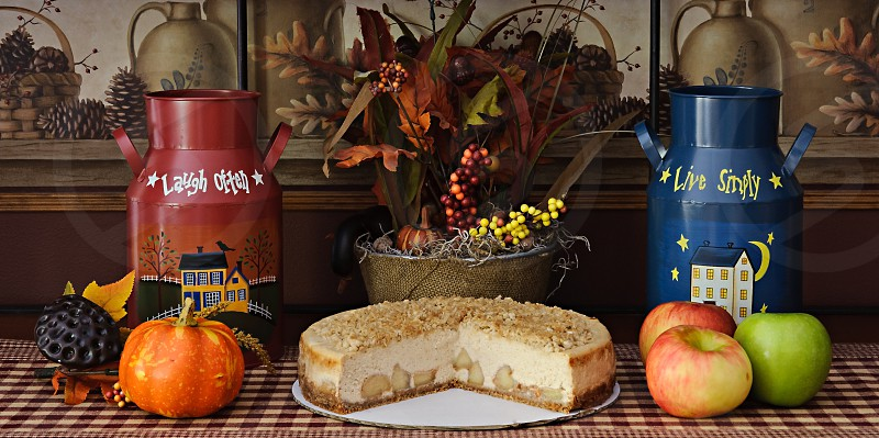 Food Photography - Caramel Apple Crisp Cheesecake with a slice cut out in a fall arrangement. photo