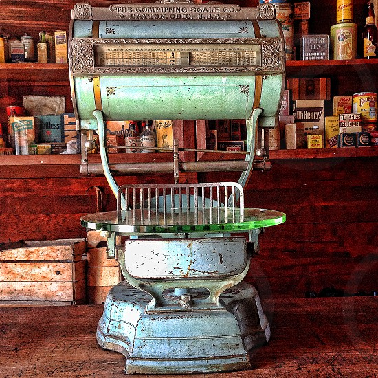 A vintage scale sit inside an old store photo