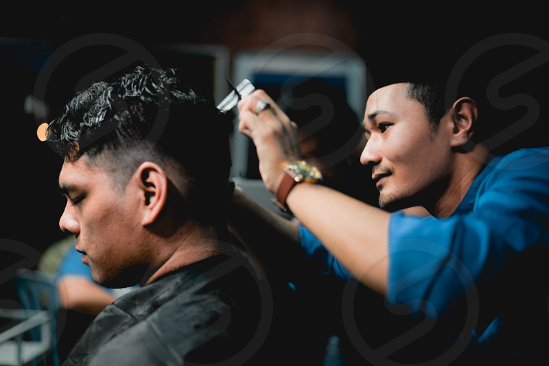 Barber having fun at work photo