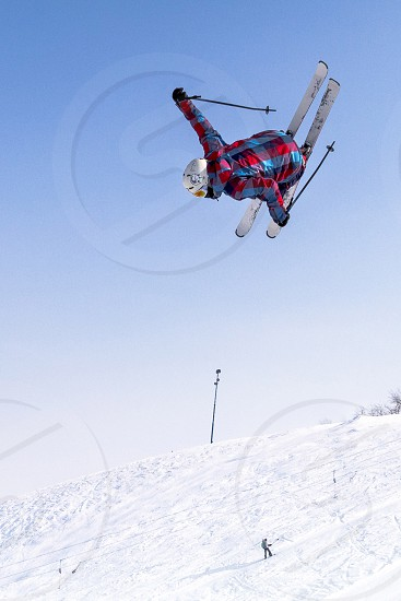 Freestyle ride ski jumping winter extreme sports snow and sky flight big air jump photo