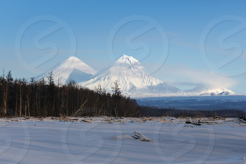 Beautiful Kamchatka mountain landscape: Klyuchevskoy Volcano (Klyuchevskaya Sopka) Kamen Volcano and Bezymianny Volcano. Russia Far East Kamchatka Peninsula. photo