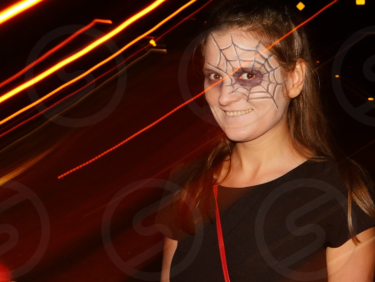 Halloween scary make up spider web on face adult light trails photo
