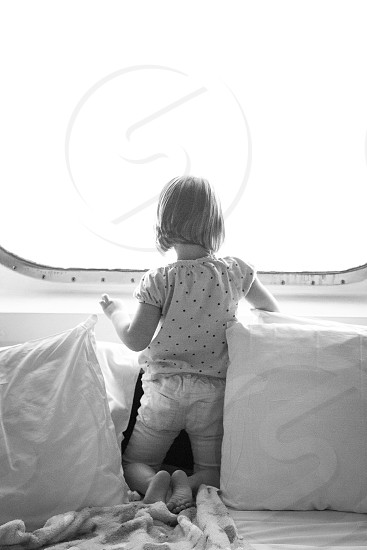 Cruise travel rest bed seaside window gazing relaxing pillow comfort ocean vacation little girl  photo