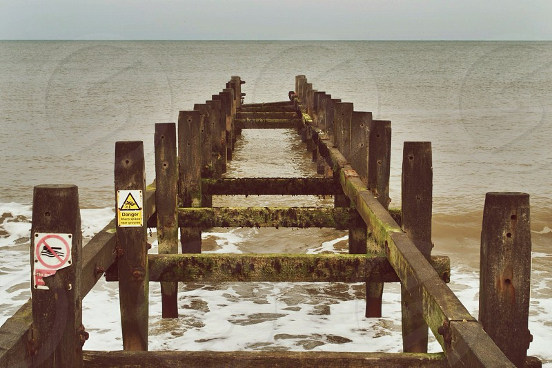 ruined beach dock photography  photo
